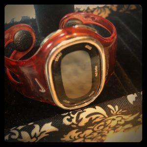 Nike stainless steel water resistant orange watch